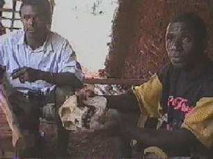 Joseph and friend with gorilla skull